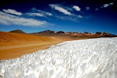 'At high altitude in Bolivia, a rare sight of desert and ice side by side.'