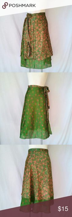 "JEDZEBEL Silk Wrap Skirt Jedzebel Reversible Green and Orange Silk/Rayon Wrap Skirt. One of the photos is in direct sunlight - such a vibrant beautiful green fabric. In excellent used condition. From a smoke free home. Make an offer! SAVE on SHIPPING & get a DISCOUNT by making a BUNDLE! Get 20% off on 2+ items. 2for1 SCARF SALE: Buy one ""2for1"" scarf at full price and get another scarf of equal or lesser value for free! Purchase the first scarf, comment on the second scarf, & I'll ship both…"
