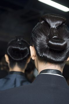HaiderAckermann hair look by Eugene Souleiman inspired by Japanese sumo hair. #pfw