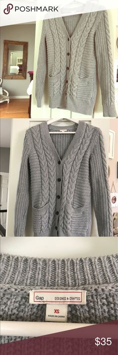 Cable knit cardigan Beautiful classic grey cable knit cardigan. In EUC. Worn once. It's a heavier cardigan, nice and warm. GAP Sweaters Cardigans