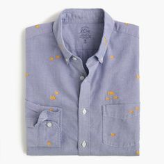 Few shirts age better than an oxford. The frays, the fades—these are the kinds of details we love. We selected this lightweight fabric with embroidered goldfish because it can (and will) hang with your old favorites. <ul><li>Slim fit, cut more narrowly through the body and sleeves.</li><li>Cotton.</li><li>Button-down collar.</li><li>Chest pocket.</li><li>Machine wash.</li><li>Import.</li><li>Online only.</li></ul>