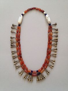 An astoundingly beautiful Ao Naga necklace from Tesori Orientali. With carnelians, shells, glad beads and brass trumpets. Ethnic Jewelry, Textile Jewelry, African Jewelry, Indian Jewelry, Beaded Jewelry, Beaded Necklace, Ancient Jewelry, Antique Jewelry, Collar Hippie