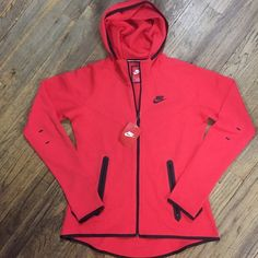 Nike Women Tech Fleece Full-Zip Hoodie Jacket  Brand New with Tags! Nike Women Tech Fleece Full-Zip Hoodie Jacket   Color- Daring Red and Black.. Has zippered pockets. The Nike Tech Fleece Full-Zip Women's Hoodie is made from an innovative cotton blend with raglan sleeves for lightweight warmth and freedom to move. Nike Tops Sweatshirts & Hoodies
