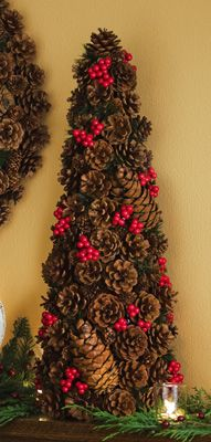 Not hard to make: get a foam cone, cover in pine cones with hot glue, add holly from craft store.