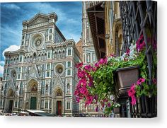 A view in the streets of the city of Firenze with beautiful flowers in the foreground and the Cattedrale di Santa Maria del Fiore in the background. A beautiful blue sky with clouds accompanies the scene. The image gets printed onto one of our premium canvases and then stretched on a wooden frame of stretcher bars. Click through the image to customize your print for your home or office! Travel art for your wall by Eduardo Jose Accorinti.