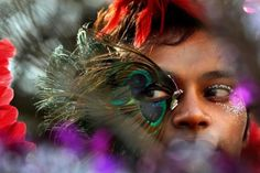 Mumbai    A participant wears a feathered mask during the Queer Azadi (azadi means freedom) parade, an event promoting gay, lesbian, bisexual and transgender rights in Mumbai.
