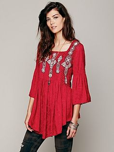 Embroidered In Jacquard Top | Embroidered eyelet billowy top with jacquard patterned sleeves and flouncy bottom portion. Square drop at the upper back with ties across the top. Sleeves are slightly bell shaped. Hems have scalloped trimming.