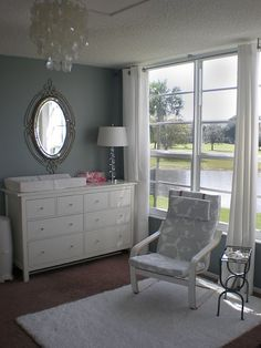 I love this grey and white! and that chair!   WHITE CURTAINS