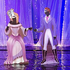 Our Purple Masquerade Couple Standees are dressed in 1800's masquerade ball attire. The free-standing cardboard cutouts measure 6 feet 2 inches high.