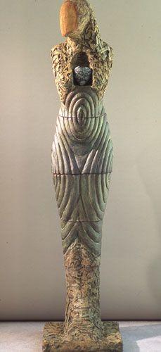 """Clayton Thiel  Totem Figure w/ Heart  68"""" x 16"""" x 17"""" Ceramic & Stone"""