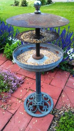 ReInvented Bird feeder from bird bath, tractor discs,