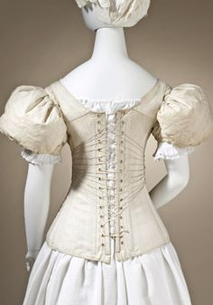 Sleeve Plumpers: England 1830-35. Linen plain; weave and down fill.  Corset: England, 1830-40. Cotton sateen, quilted, with cotton twill and cotton plain-weave tape.
