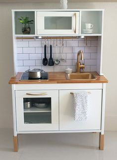 "Incredible Ways to ""Remodel"" IKEA's DUKTIG Play Kitchen Ikea kitchen with added backsplash and accents.Ikea kitchen with added backsplash and accents. Play Kitchen, Kitchen Makeover, Ikea, Ikea Kids Kitchen, Kitchen, Furniture Makeover, Ikea Toys, Diy Kitchen, Ikea Kitchen"