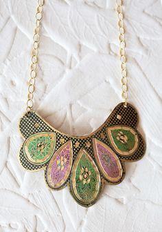 """Subtle Beauty Necklace 18.99 at shopruche.com. Etched with an intricate design, this gold colored necklace is perfected in soft hues of pink, green, and black.17"""" long, Pendant: 2.25"""" long, 4"""" wide"""