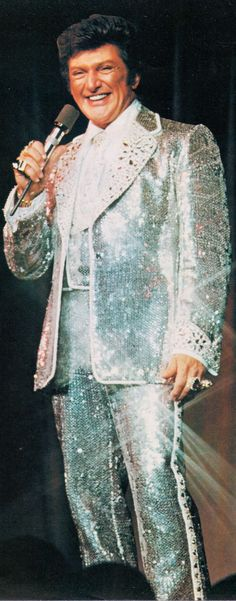 LIBERACE in a little sparkling number he just threw on. from LIBERACE '76 Australian Tour program (minkshmink)