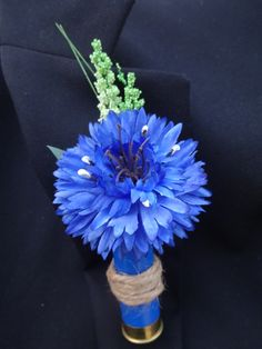 Boutonniere for him bachelor button in a spent shotgun shell