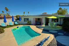 Mid-Century Modern Palm Springs in Palm Springs. Love the backyard design for this area. Practical with design