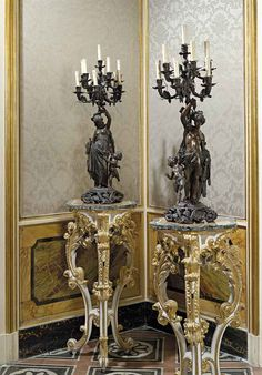 A PAIR OF ITALIAN PATINATED SPELTER FIGURAL TEN-LIGHT CANDELABRA PROBABLY NAPLES, LATE 19TH CENTURY Modelled as a female classically robed figure with attendant putto and a male heroic figure with attendant bacchic putto, each supporting a vine wrapped candelabra on a spreading vine cast base 40 in. (101 cm.) high