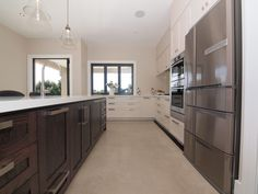Monty's Kitchen Design by Prestige Joinery. #kitchen #interiordesign #kitchendesign #oak #stone #prestigejoinery #prestigekitchenswairarapa