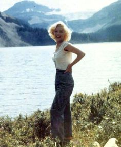 "A very rare, natural, beautiful color photo of Marilyn Monroe in Alberta, Canada 1953 standing barefoot in front of Lake Louise with snow covered peaks in the background. Enjoying a day off from filming, ""River of No Return""."