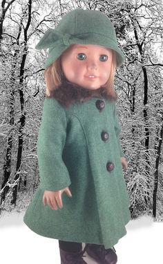 While I already own a raspberry colored wool coat in this pattern, I feel the two coats are quite different in execution. This one has an adorable rabbit fur collar. The coat and hat are of sage green wool and has leather textured buttons down the front.