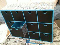 Ikea Moppe hack - decoupage paper, turquoise paint + chalkboard paint.