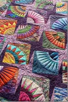 This is Ulrike's stunning New York Beauty quilt and she said it took her 10 years to complete this top! It is made with all batik fabrics and batik backing. The blocks and border were all paper pi
