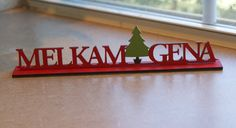 "$15 on Etsy.  Melkam Gena means ""Merry Christmas"" in Amharic.  1 inch deep by 8 inches wide.