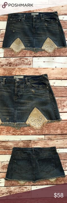 "Free People Tire Swing Distressed Denim Skirt Free People Tire Swing Cut-off Distressed Denim Skirt (size 6)  Featuring Eyelet Panels, Button Fly, 5 Pocket Styling, Cut-off Hem  Measurements: Waist 16"" Length 12"" Free People Skirts Mini"