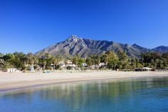 Marbella sandy beach summer holiday scenery by the Mediterranean Sea in Spain, Andalusia region, Costa del Sol, Malaga province. Marbella Beach, Freundlich, Sandy Beaches, Cruise, Spanish, Scenery, Coast, New York, Travel Tips