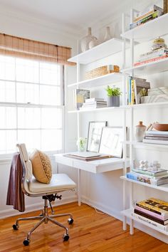 We love the leaning frames in this gorgeouse workspace | via Katie Hodges Design Los Angeles Home