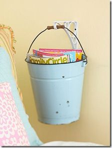 A bucket for magazines... Cute for beach theme guest bedroom!