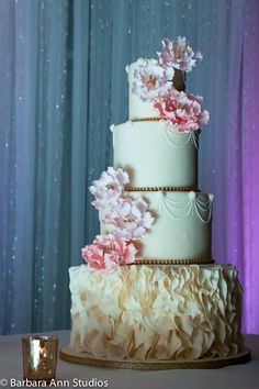 Ruffle wedding cake with swag piping details!