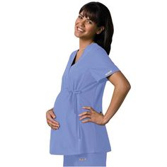 There's no need to wear frumpy uniforms to cover up your bump, try the stylish Cherokee Maternity top in Ceil. Only £29.99. Ships internationally. #maternitytop  #medicalscrubs #nursescrubs #dentistscrubs #nurses #dentists #bluescrubs #nurseuniform #maternityscrub
