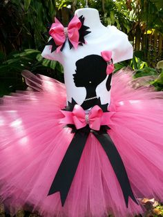This hand-made Barbie silhouette tutu set consist of Tutu, Top, and bow. This beautiful Pink tutu is made with shocking pink good quality tu...