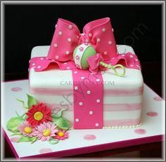 Gift Box Cake with Baby Rattle: This cake was inspired by the Baby Shower invitation.  I always add something extra to the cakes and in this case it was the fun and girly daisies.  Where