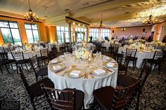 White and gold wedding at Bella Collina. Photography by Corey Conroy. Vangie's Events of Distinction, Blossoms Arrangements of Distinction, Orlando, Florida. White wedding flowers, white floral centerpieces, yellow uplighting, wedding reception.