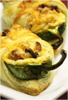 Jalapeño peppers stuffed with roasted garlic, cream cheese, cheddar cheese, and bacon bits then wrapped in puff pastry