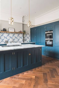 Dark Blue Geometric Kitchen - Sustainable Kitchens Dark blue geometric kitchen with parquet flooring Decking of any house is one of the most remarkable interior architectu. Wood Floor Kitchen, Kitchen Chairs, Kitchen Tiles, Kitchen Flooring, Kitchen Decor, Blue Kitchen Ideas, Rustic Kitchen, Wood Tile Floors, Parquet Flooring