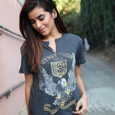 "Blogger Sazan wears a Lucky Brand graphic tee in her October 2014 post ""Fall Staples with Lucky Brand""."