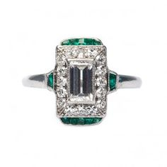 so so so so so perfect.  vintage art deco diamond and emerald ring