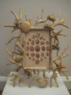 great idea for driftwood and shells... Jay Strongwater - coral and shells are completely artificial. Lovely depth in his work. Coral pieces have dimpled texture, shells are mostly true to life in size, but enhanced with enamels, glaze, and aurora borealis rhinestones, as is some of the coral. If you can still view it on ebay, it's worth a look.