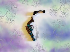 SALE--Belly Ring, Antique Bronze Cowgirl Pistol Gun with Turquoise Blue Crystal Rhinestones, Belly Button Ring, Belly Button Jewelry for Her by Aim4Beauty on Etsy