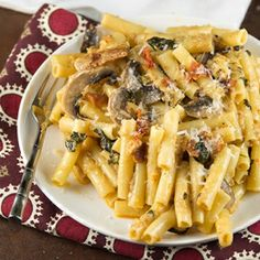 Smokehouse Bacon Ziti Alfredo: an easy pasta recipe with bacon, spinach and mushrooms in a smokey, alfredo sauce! Ready in 30 minutes!