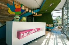 Human.Kind Offices by PPS Architects Love the bright colors and the faux grass treatment on the walls and ceiling!