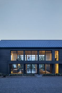 The Cap St-Martin House is located at the end of a long winding road in Potton, Quebec. Barn House Design, Modern Barn House, Barn House Plans, Contemporary Barn, Compact House, Lokal, Home Design Plans, Maine House, Quebec