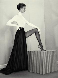The thing about Karlie Kloss that is so striking to me is her flexibility and posture. Not everyone can hoist their leg this high and still stand up tall with hips under shoulder, ie, not sticking her butt out. Karlie Kloss - ACNE Paper by Roe Ethridge, Fall/Winter 2012-13