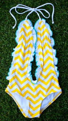 """Hands down one of our best sellers. Feminine and fun this one piece is always a favorite for the beach or pool. Who can pass up a bunch of ruffles? <meta charset=""""utf-8"""" /> XS = Newborn - 1 Year S = 1"""
