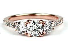 18ct rose gold three stone engagement ring with diamond set shoulders OMG! This is it