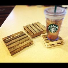 Popsicle sticks & hot glue gun - mini pallet coasters! These are so stinkin' cute! Soak in tea/coffee to give them their color :)